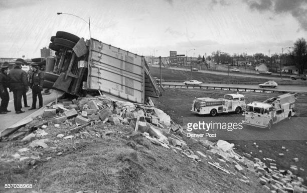 Truck overturns on Interstate Ramp This truck loaded with boxes of shredded coconut overturned about 4 pm Saturday as it was traveling up a ramp from...