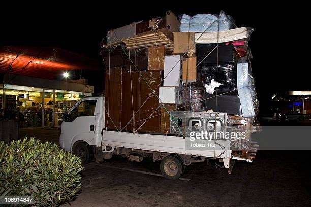 A truck packed with furniture and household items