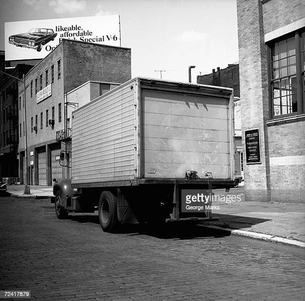 Truck parked at sidewalk, (rear view), (B&W)