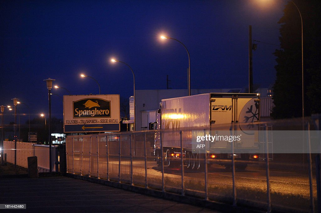 A truck passes in front of a sign reading 'Spanghero, meats, transports, social headquarters' in front of the headquarters of French meat supplier Spanghero, in Castelnaudary, southern France, on February 11, 2013. The Europe-wide scandal over horsemeat sold as beef spread on February 10 as leading French retailers pulled products from their shelves and threats of legal action flew. The suspect lasagne meals sold by Swedish frozen food giant Findus in Britain were made by French company Comigel using meat supplied by French meat-processing firm Spanghero.