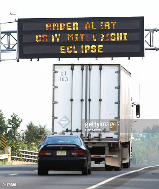 A truck passes under an Amber Alert sign on Interstate 295 August 22 2003 in Princeton New Jersey An Amber Alert was issued for a 3yearold hispanic...