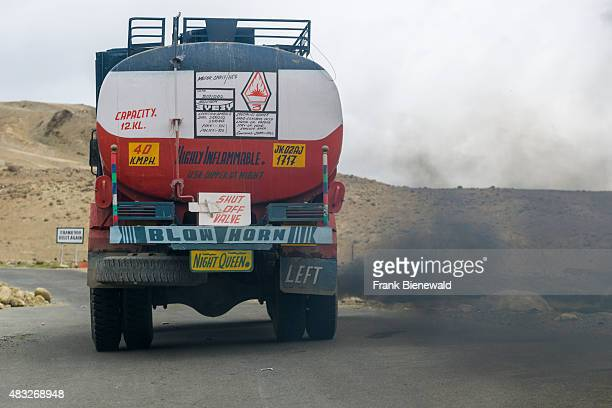 A truck producing black fumes and pollution is driving up to Taglang La the highest pass on the ManaliLeh Highway