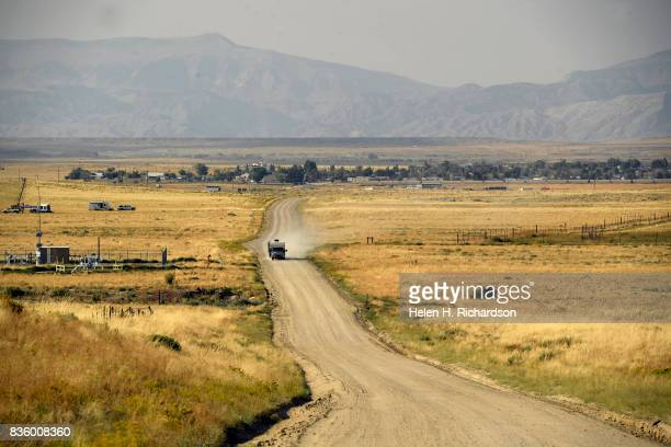 A truck pulling a trailer heads out onto an empty road seeking dead center of the totality zone on August 20 2017 in Shoshoni Wyoming Shoshoni is...