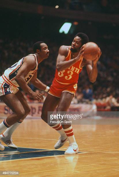 Truck Robinson of the Atlanta Hawks looks to put a move on George McGinnis of the Philadelphia 76ers during an NBA basketball game circa 1977 at The...
