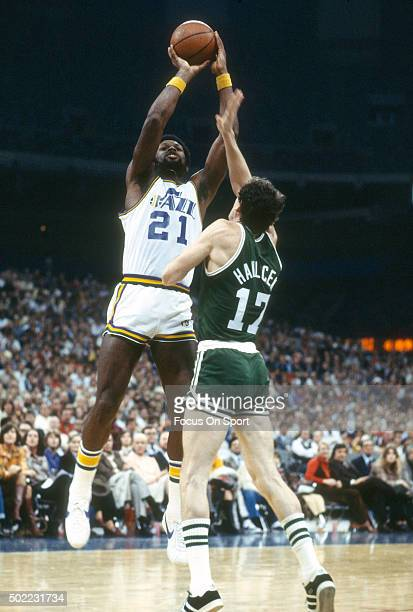 Truck Robinson of the New Orleans Jazz shoots over John Havlicek of the Boston Celtics during an NBA basketball game circa 1978 at the Louisiana...