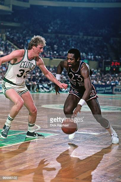 Truck Robinson of the New York Knicks drives to the basket against Larry Bird of the Boston Celtics during a game played in 1983 at the Boston Garden...