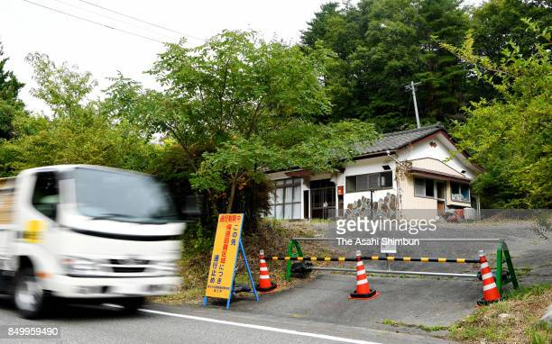 A truck runs past an abondoned house on September 20 2017 in Namie Fukushima Japan A 27kilometer section of National Round 114 was finally reopened...