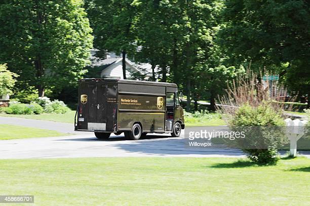 UPS Truck Rushing Through Suburban Neighborhood