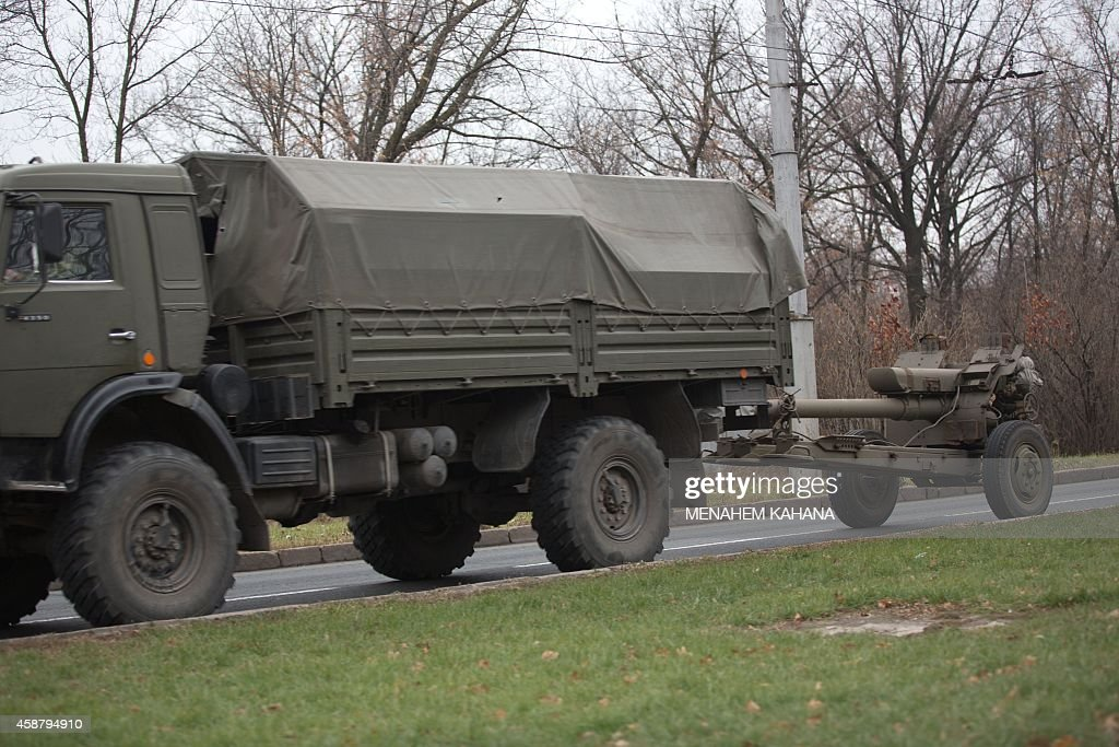 A Truck seen towing a 122mm howitzer artillery piece on November 11 2014 on a main road East of Donetsk The risk of violence in wartorn eastern...