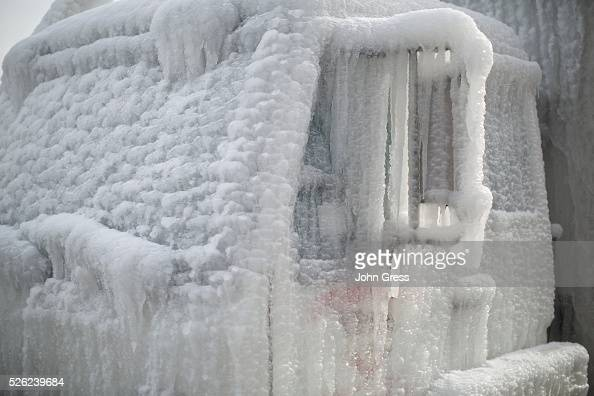 A truck sit encased in ice on January 24 following a warehouse fire which is still burning and started in Chicago on Tuesday Fire Department...