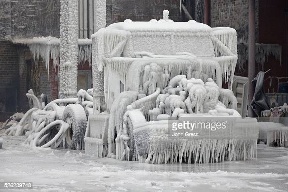 A truck sits encased in ice January 23 after a warehouse fire in Chicago Fire Department officials said it is the biggest fire the department has had...