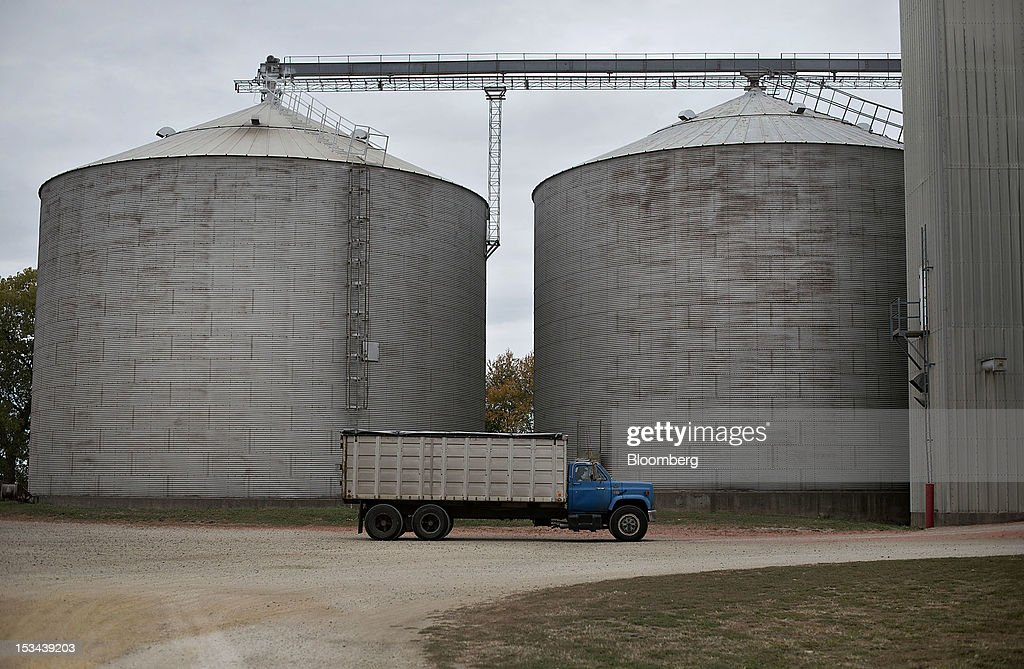 A truck sits near large grain storage bins at the Atherton Grain Co. Inc. elevator in Normandy, Illinois, U.S., on Wednesday, Oct. 3, 2012. Soybeans climbed for a third day as U.S. export sales jumped, boosted by purchases from China. Photographer: Daniel Acker/Bloomberg via Getty Images