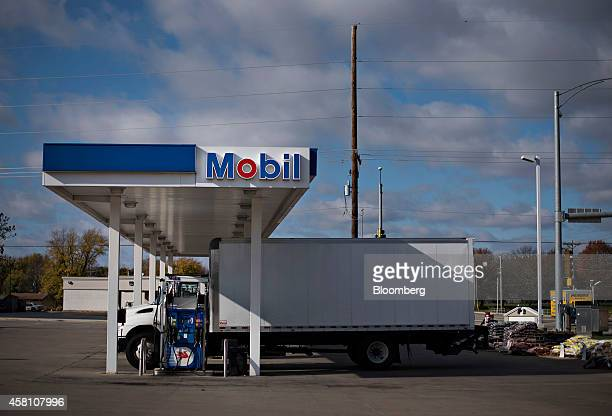 A truck sits next to a fuel pump at a Mobil gas station in Washington Illinois US on Wednesday Oct 29 2014 Exxon Mobil Corp is scheduled to report...
