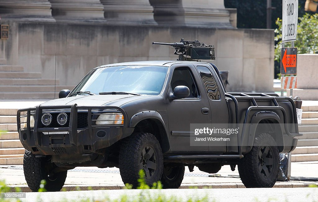 A truck sits on Fifth Avenue on the set of 'The Dark Knight Rises' filming near the Carnegie Mellon University Software Engineering Institute Building in the neighborhood of Oakland on July 30, 2011 in Pittsburgh, Pennsylvania.