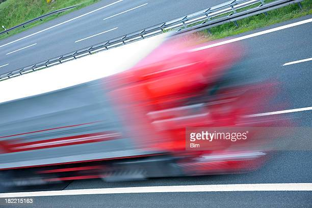 Truck speeding on highway, blurred motion, high angle view