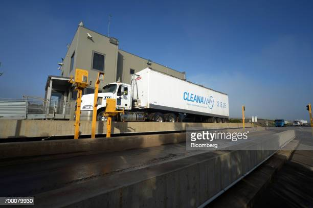 A truck stops at a weighbridge at the Melbourne Regional Landfill site operated by Cleanaway Waste Management Ltd in Ravenhall Victoria Australia on...