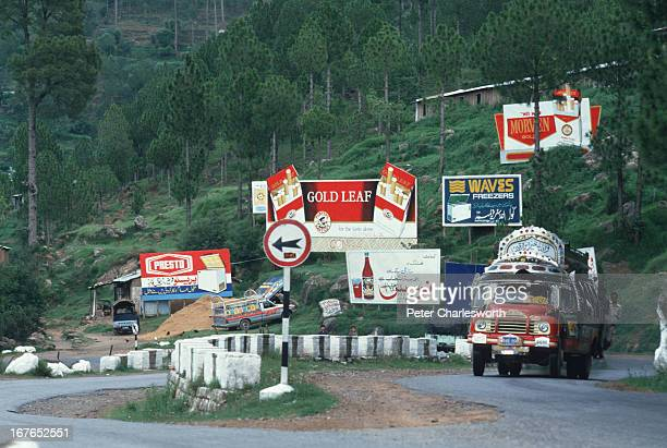 A truck struggles to climb the hill that leads to the old hillstation town of Murree The switchback road is dotted with billboards advertising...