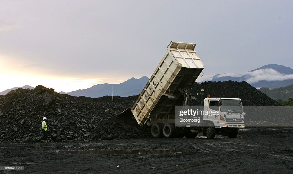 A truck tips coal onto a stockpile at the PT Exploitasi Energi Indonesia operations in Asam-Asam, South Kalimantan, Indonesia, on Monday Oct. 29, 2012. Indonesia, the world's largest exporter of coal for electricity generation, will reduce the amount of the fuel that producers must sell to buyers inside the country for next year by 9.4 percent. Photographer: Dadang Tri/Bloomberg via Getty Images