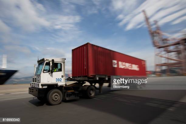 A truck transporting a shipping container drives through the Busan Port Terminal in Busan South Korea on Monday July 17 2017 South Korea's exports...