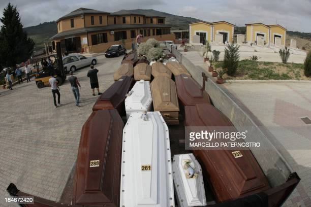 A truck transporting coffins arrives at the Piano Gatta's cemetery before the funeral of immigrants on October 15 2013 in Agrigento in Sicily Dozens...