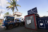 A truck transporting coils of steel leaves the manufacturing facility of Uttam Galva Steels Ltd the Indian unit of ArcelorMittal stands in Khopoli...