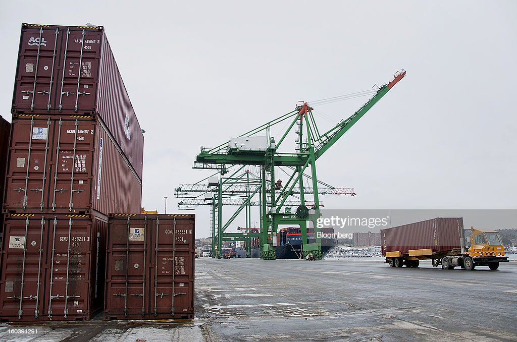 A truck transports a freight container from an Atlantic Container Line (ACL) ship docked at the Port Of Halifax's Fairview Cove container terminal, operated by Cerescorp Co., in Halifax, Nova Scotia, Canada, on Wednesday, Jan. 30, 2013. Statistics Canada (STCA) is scheduled to release gross domestic product data on Jan. 31. Photographer: Aaron McKenzie Fraser/Bloomberg via Getty Images