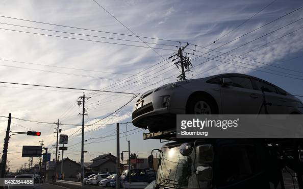 A truck transports a Toyota Motor Corp thirdgeneration Prius hybrid vehicle outside the Motomachi plant in Toyota City Aichi Japan on Friday Oct 14...