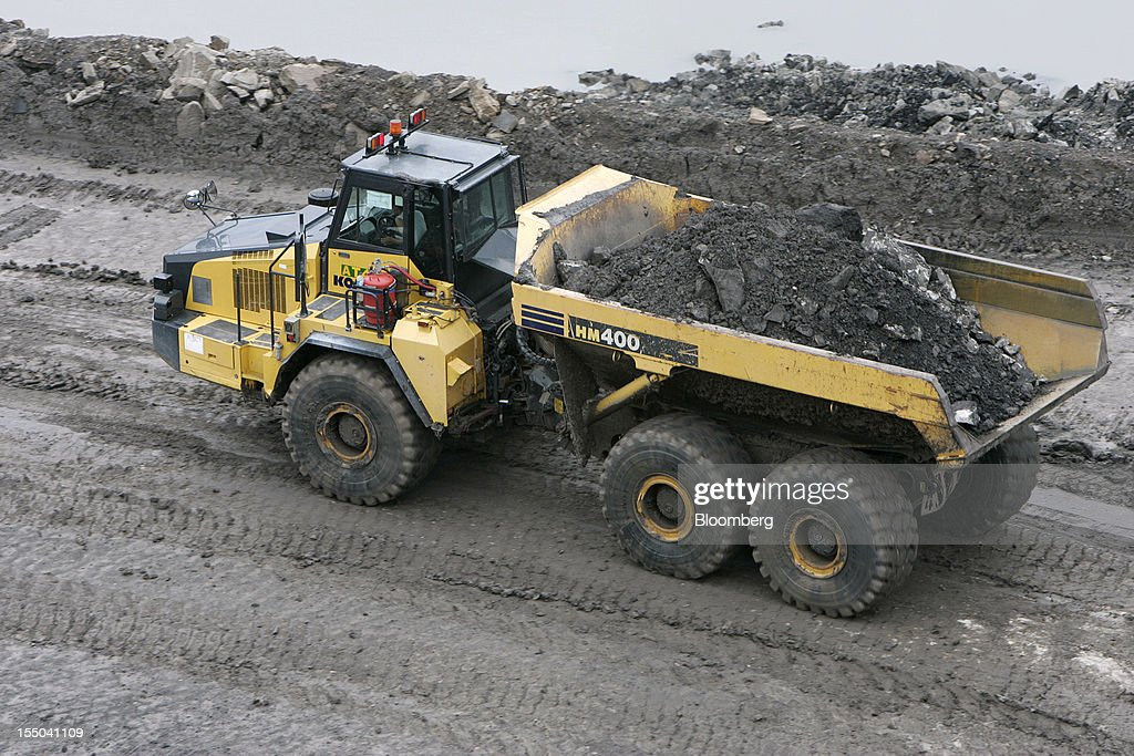 A truck transports coal in the open pit coal mine at the PT Exploitasi Energi Indonesia operations in Asam-Asam, South Kalimantan, Indonesia, on Monday Oct. 29, 2012. Indonesia, the world's largest exporter of coal for electricity generation, will reduce the amount of the fuel that producers must sell to buyers inside the country for next year by 9.4 percent. Photographer: Dadang Tri/Bloomberg via Getty Images
