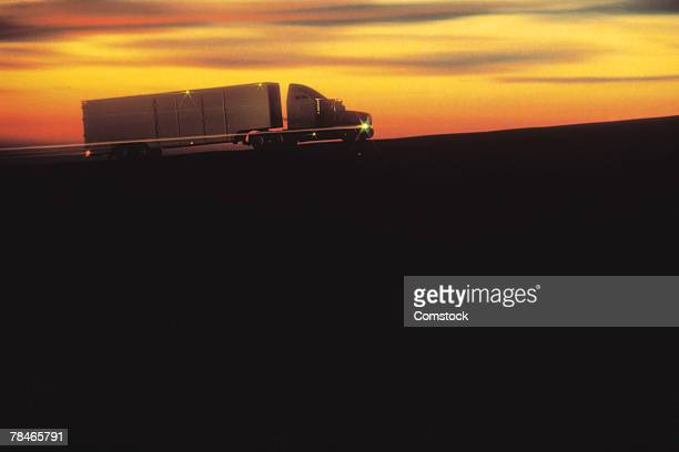 Truck traveling at dusk