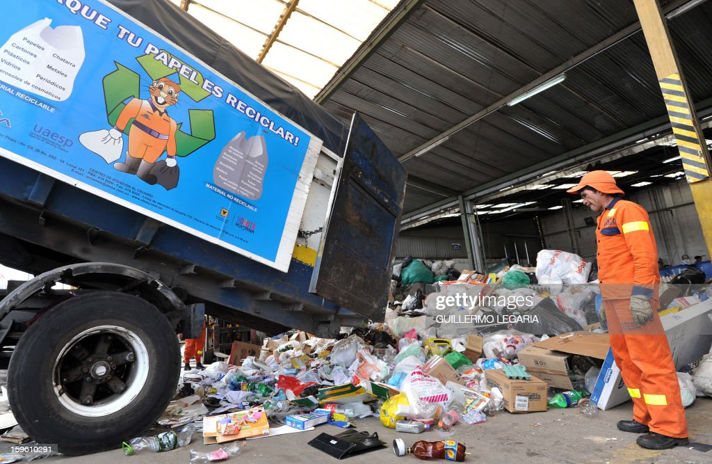 A truck unloads recyclable garbage at La Alqueria Recycling Center in Bogota, Colombia, on January 17, 2013. Some 60 recyclers classify 10 tons daily of potentially recyclable waste at this recycling center wich is part of Bogota's Mayor program 'Basura Cero' (Zero waste). AFP PHOTO/Guillermo LEGARIA