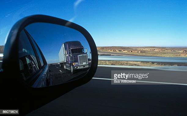 Truck visible in rear view mirror