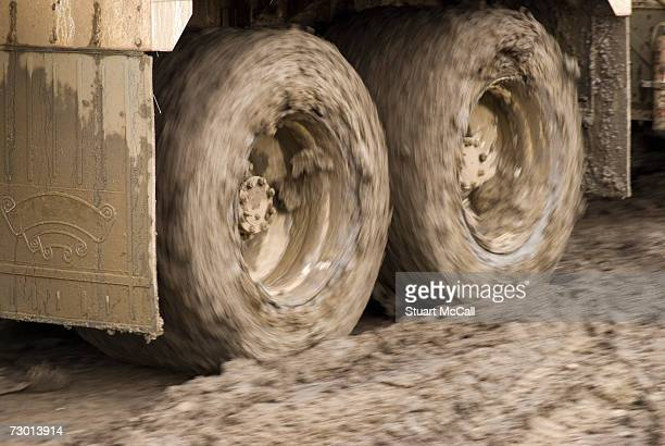 Truck wheels covered with mud at natural gas plant