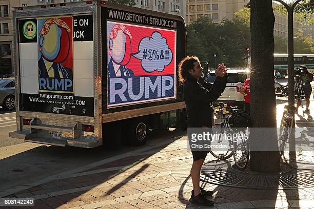 A truck with a digital billboard parks in front of the newly opened Trump International Hotel during a protest against Republican presidential...