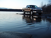 A great shot featuring a new body style 2004 Ford F-150 Lariat 4X4 Supercab parked near water.