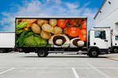 Truck with vegetables parked outside distribution warehouse