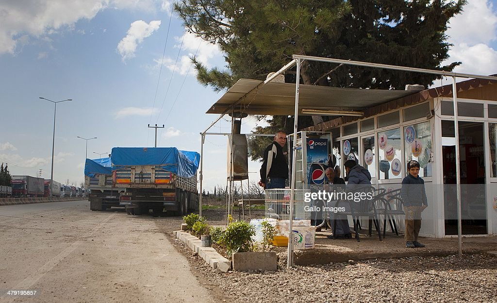 Truckdrivers drinking tea and having Kebaps at a roadside shop on March 12, 2014, in Killis City, Turkey. The truck driver has been at the Kilis border now for 14 days, waiting to go through to the Syrian side. Truck drivers at the Turkish/ Syrian border near Kilis City wait 10-15 days to get their good through to the customs area where Syrian truckers can take the load to Syrian towns. Since ISIS moved out of the nearby Area of Azzaz more goods are collected by the Syrian trucks on the Bab Al Salame border.
