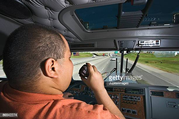 Trucker driving and using cb radio