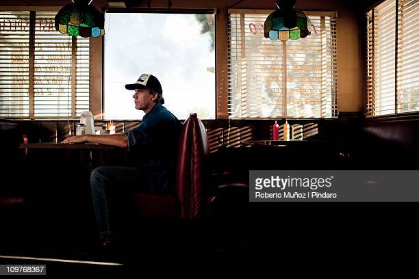 Trucker waiting for service in a diner