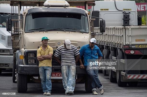 Truckers remain on standby as lorry drivers on strike block the road in Trevo de Itabira 80 km from Belo Horizonte Brazil on November 9 2015 during a...