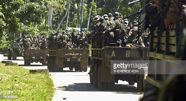 Truckloads of combat troops from the Philippine Army are escorted by an armored vehicle as they move to the frontline in the restive southern...