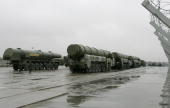 Truckmounted TopolM intercontinental ballistic missiles stand ready for rehearsals for the Victory Day parade in Moscow's Red Square at a training...
