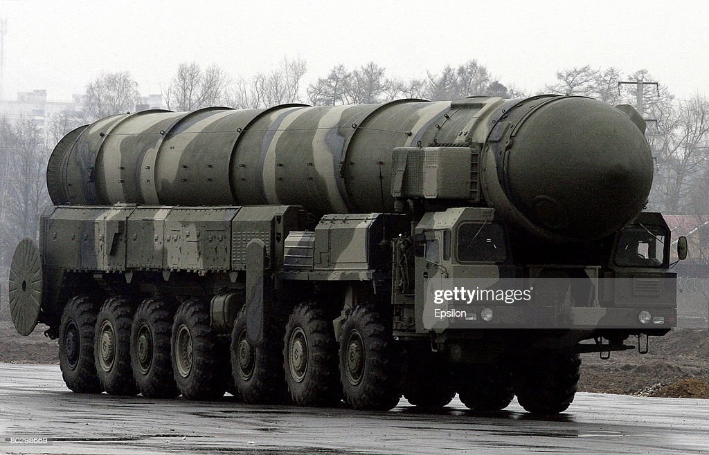 Truckmounted TopolM intercontinental ballistic missiles stand ready for rehearsals for the Victory Day parade at a training field on March 18 2008 in...