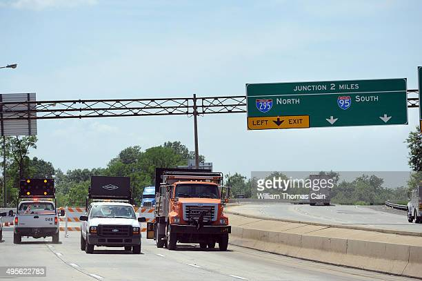 Trucks and barriers block the entrance to I495 north to the bridge over the Christina River June 4 2014 in Wilmington Delaware The bridge was closed...