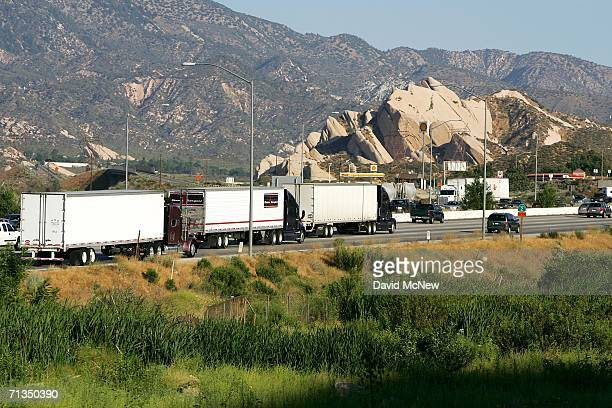 Trucks and cars move along Interstate 15 in Cajon Canyon near the San Andreas Fault on July 1 2006 near San Bernardino California The freeway which...