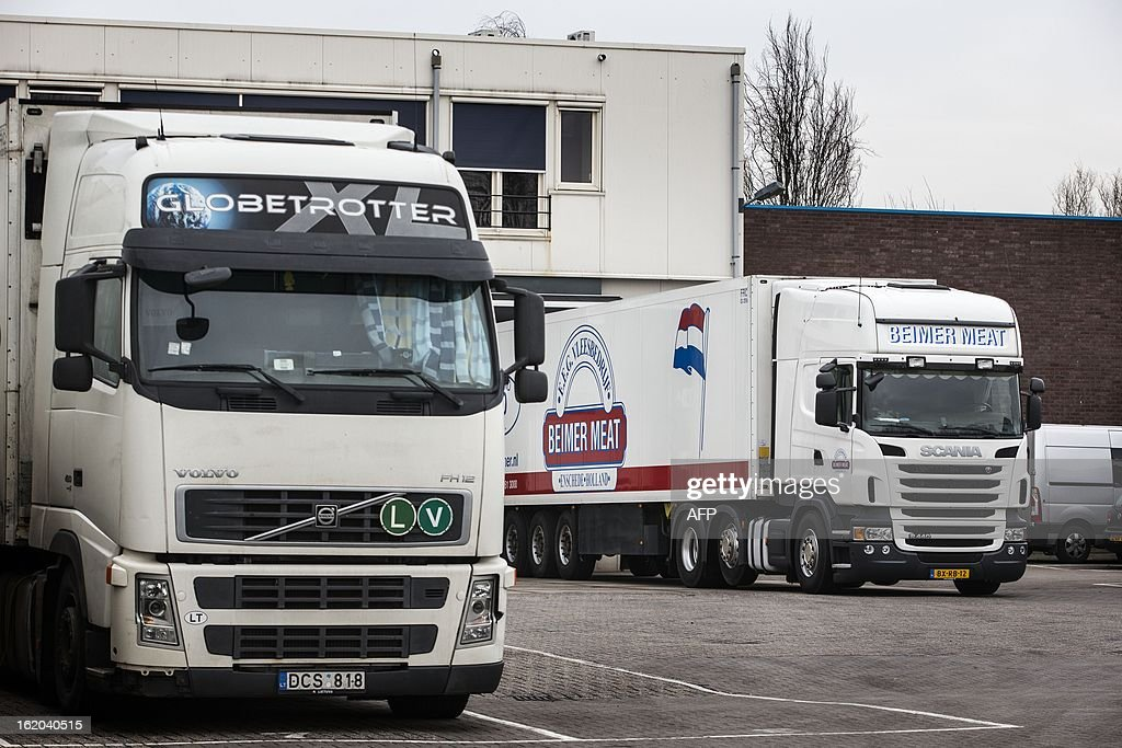 Trucks are parked outside Dutch meat supplier Beimer Meat in Enschede on 18 February 2013, where Dutch food safety inspectors carried out emergency checks today following reports it had supplied meat contaminated with the potentially lethal EHEC bacteria to a Swedish wholesaler. netherlands out