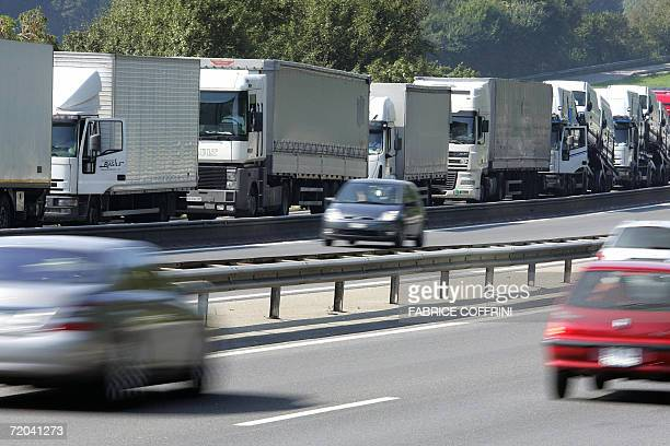 Trucks are queuing 29 September 2006 near Sempach after the 17 kilometrelong Gotthard main road tunnel linking Italy and Switzerland under the Alps...