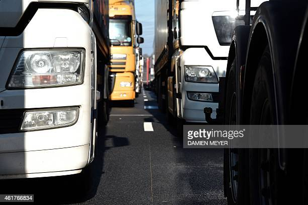 Trucks are stuck on the ring road around Rennes as lorry drivers carry out a goslow operation on January 19 at the start of a lorry drivers' strike...