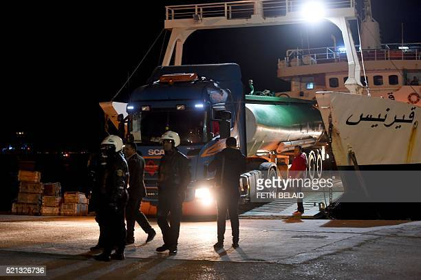 Trucks arrive in the Tunisian island of Kerkennah escorted by police as they try to reach UK based oil company Petrofac's natural gas facility on...