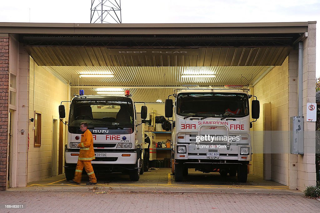 CFS trucks at the Summertown CFS station stand ready to respond to a nearby fire at Cherryville on May 10, 2013 in Adelaide, Australia. The out of control bushfire has burned 250 hectares (617 acres) of rugged terrain in the Adelaide Hills, claiming one house, and threatening more property.
