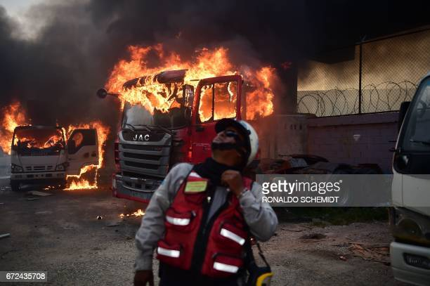 Trucks burn in flames during a demonstration by Venezuelan opposition activists against President Nicolas Maduro in Caracas on April 24 2017...